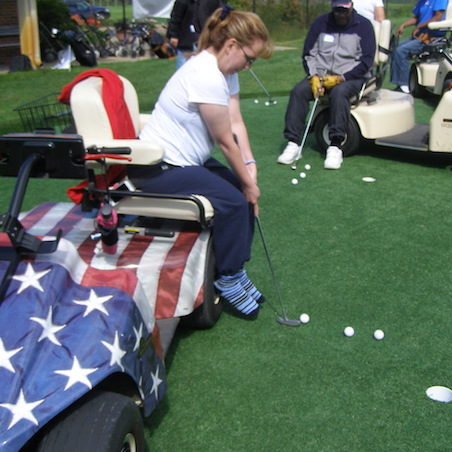 Veteran woman in wheelchair putting