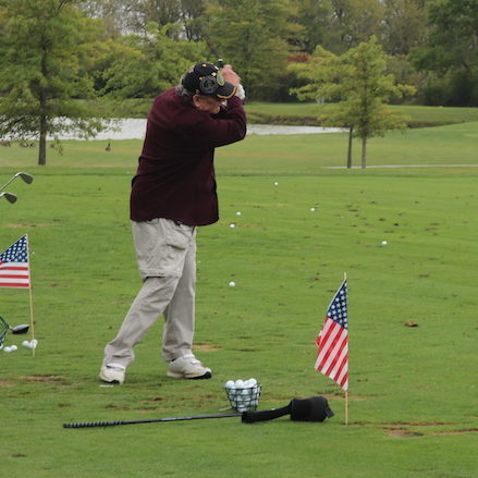 Veteran swinging on driving range